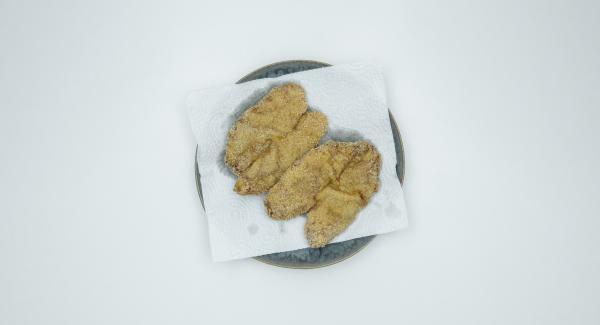 Aus der HotPan Prime nehmen, auf Küchenpapier etwas abtropfen lassen und am besten sofort servieren.